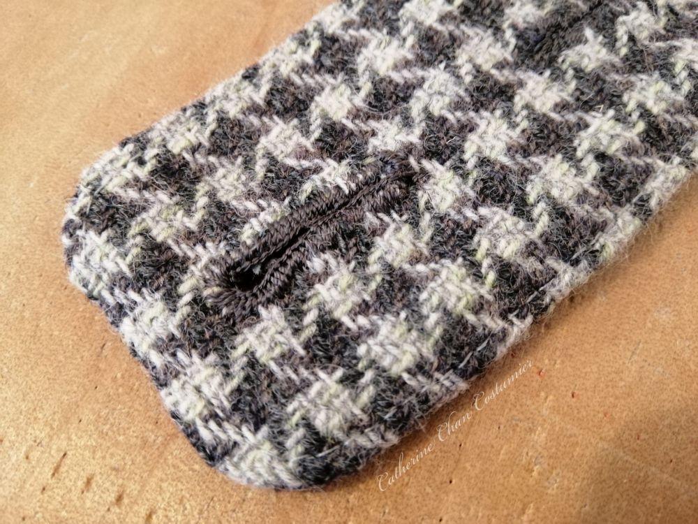 Hand-sewn buttonhole in silk thread